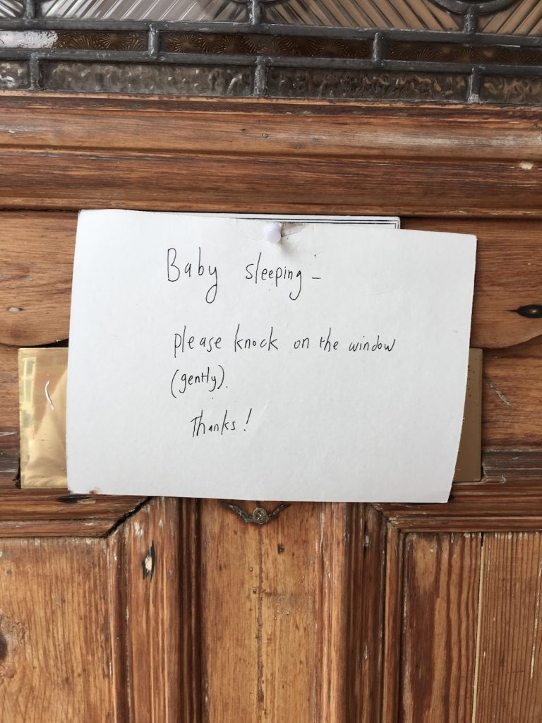 baby naptime sign on door